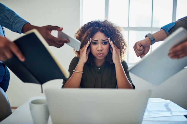 A women overwhelmed by work should learn how to deal with stress