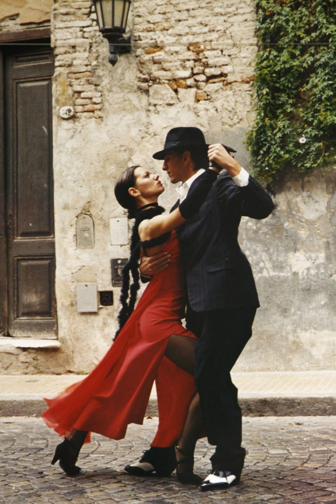Partner dances: a couple dancing Tango