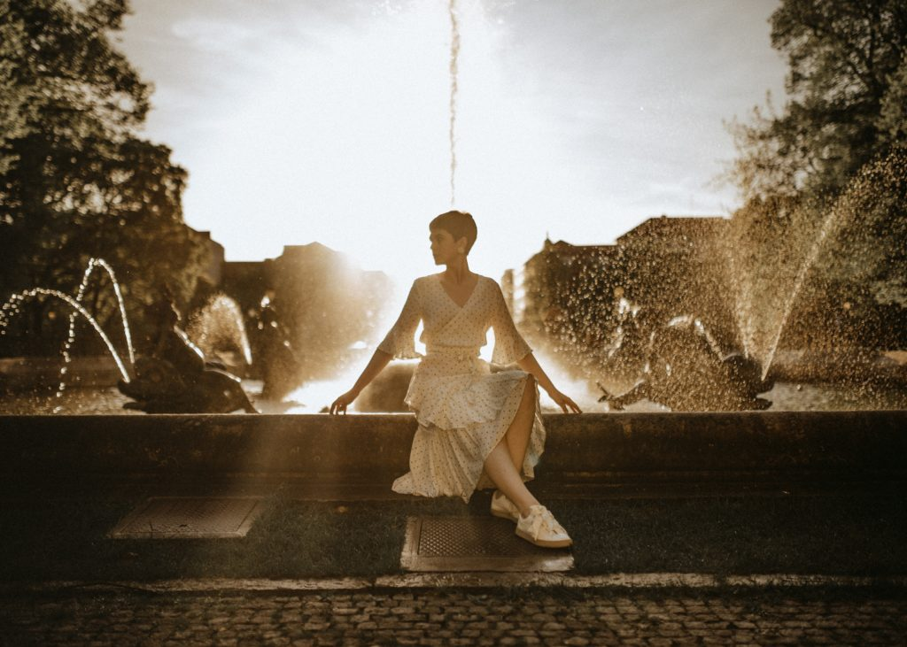 girl near fountain at one of the biggest fashion capital in the world, Paris