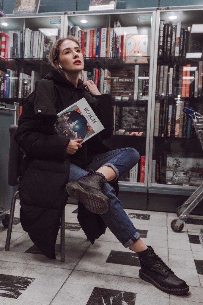 sapiosexual girl posing with book in bookshop