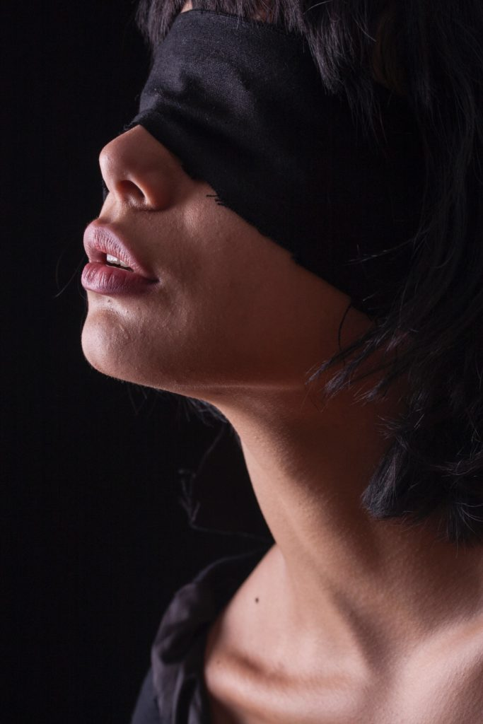 woman playing one of the most popular erotic games blindfolded