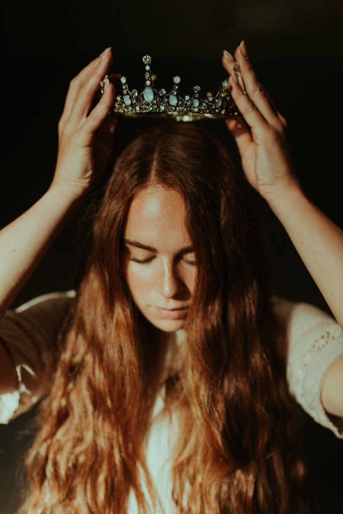 girl putting on a crown