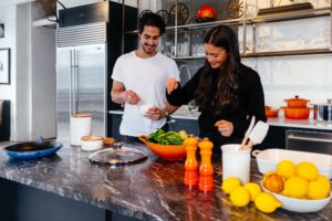 couple cooking together in quarantine