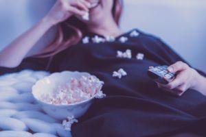 girl eating popcorn during quarantine