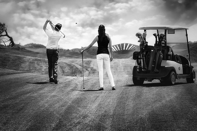 couple playing golf together