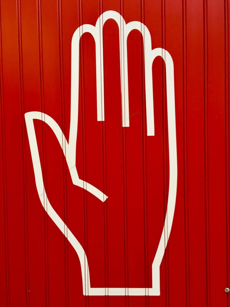 upward hand to remind of safety measures regarding video calls