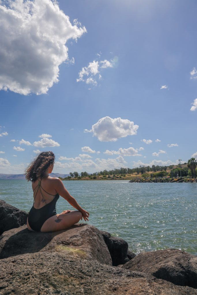 girl meditation at beach