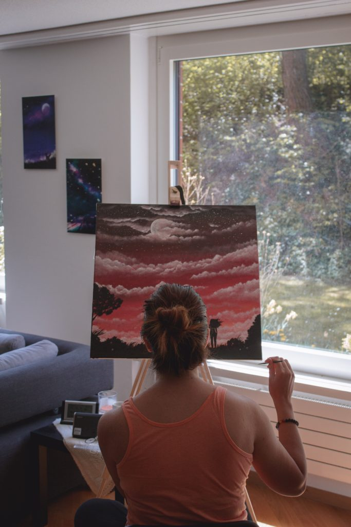 girl painting in flow state