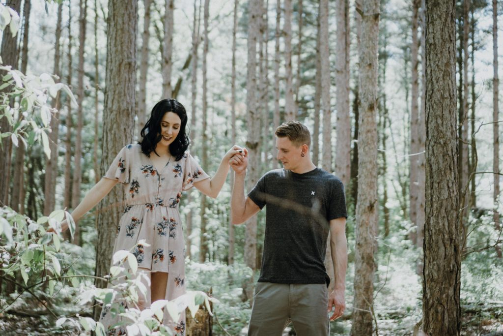 cute cuffing couple walking in a snow-covered forest