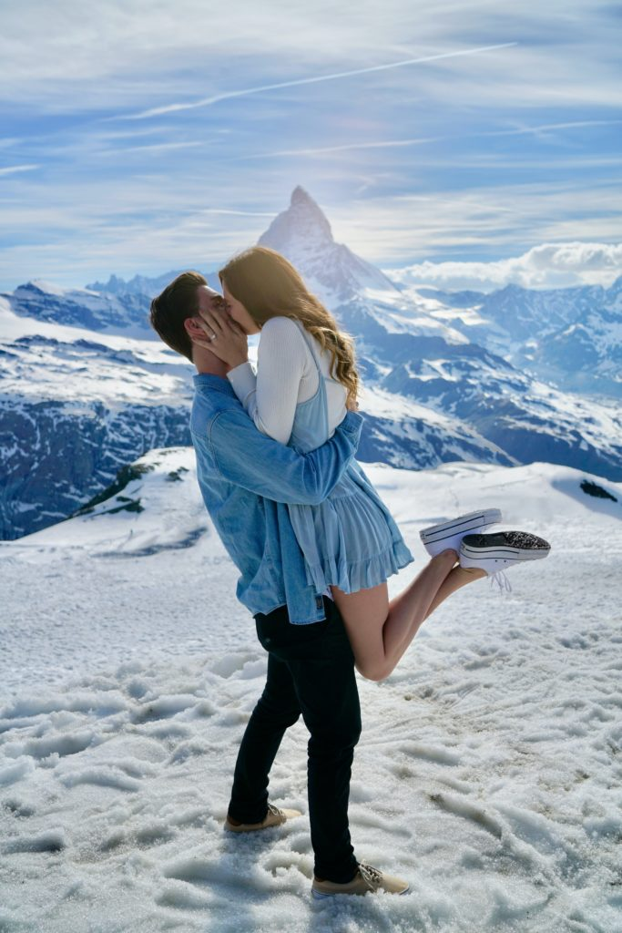 couple having fairy tale proposal on a mountain