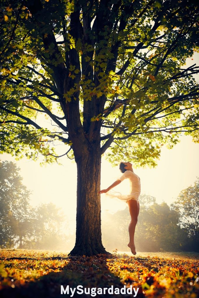 woman feeling the effects of oneness under a tree