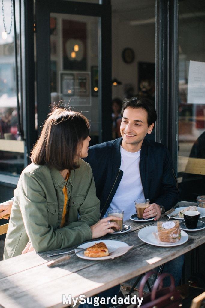man and woman on first date discussing who will pay