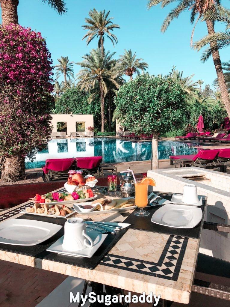 women want lavish breakfast table near luxurious pool